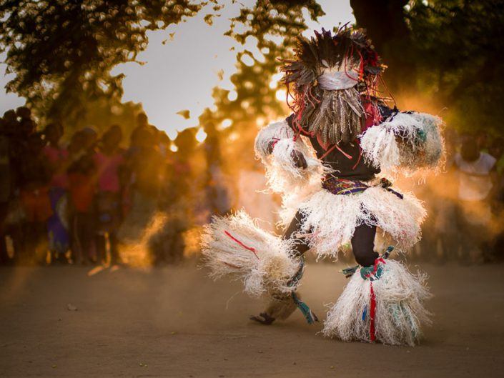 A Gule Wamkulu dancer is captured during an energetic performant near Chikwawa, Malawi; the Gule Wamkulu is a captivating ritual dance performed by the Chewa people of Malawi to represents spirits and the dead.