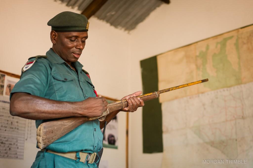 Tizola Moyo demonstrates a homemade muzzleloader